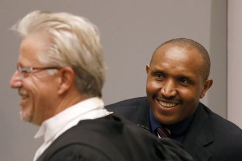 Bosco Ntaganda and his lawyer Stephane Bourgon at the ICC in 2018 [AP]