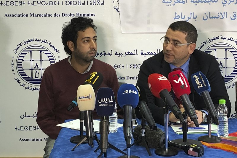 Omar Radi and his lawyer Miloud Kandil at a press conference  in Rabat in 2020 [AP]
