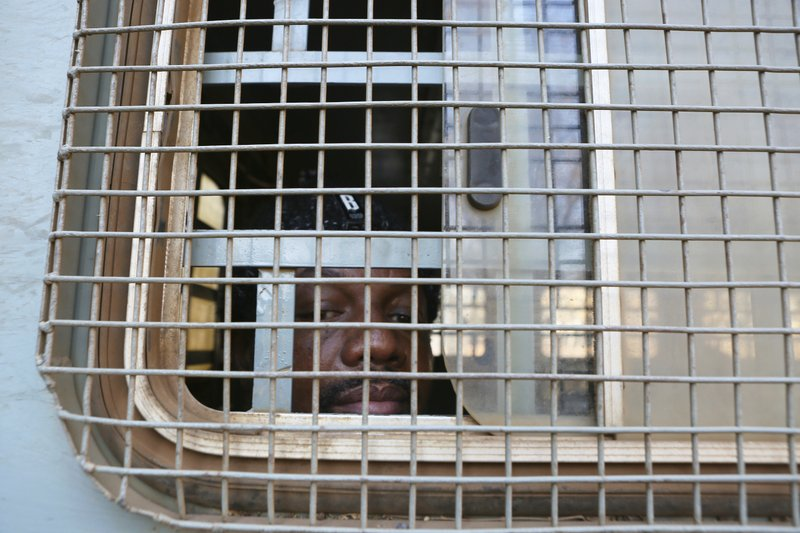 Hopewell Chin'ono seen through the window of a prison truck on 24 August 2020 [AP}