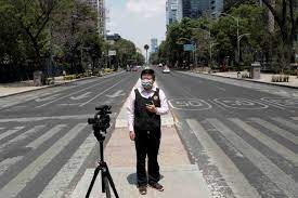 A journalist reporting during the Covid pandemic [Al Jazeera]