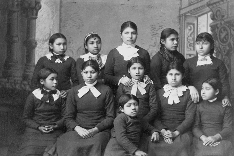 Native American girls from the Omaha tribe at Carlisle School, Pennsylvania - tens of thousands of children were taken from their parents to be 're-educated [File: Corbis via Getty Images]