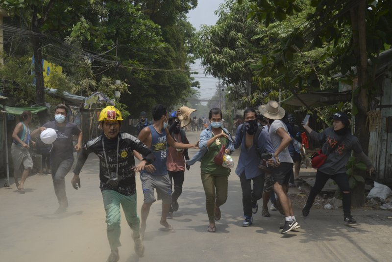 Anti-coup protesters in Yangon, Myanmar in March 2021 [AP}