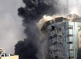 Al Jalaa building being destroyed on 15 May 2021 [Hatem Moussa /AP]